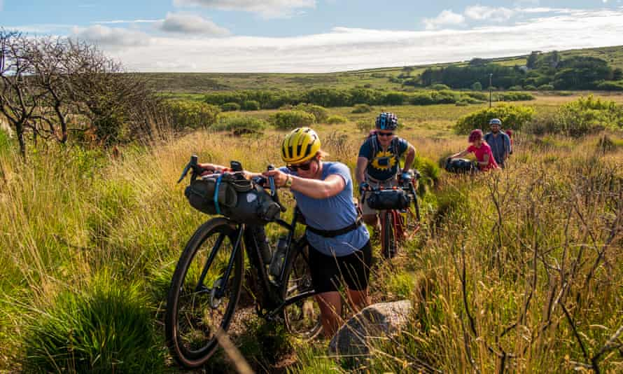 Katherine Moore (Unpaved podcast), Rob Penn (freelance journalist), Sophie Gordon (Cycling UK) and Stefan Amato (Pannier) push their bikes along a difficult overgrown bit of singletrack across the Penwith Moors during a recce ride of Cycling UK's West Kernow Way, June 2021. The 230km route is part of the EU-funded EXPERIENCE project to develop sustainable year-round tourism activities in Cornwall.