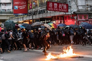 A pro-democracy protester throws a Molotov cocktail during a clash With police at a demonstration in Wan Chai district  of Hong Kong