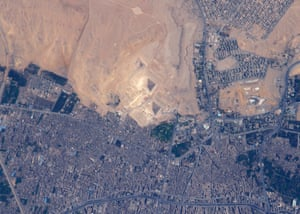El Giza, Egypt You can't see the pyramids with the naked eye from space but this is the view through an 800 mm lens.' The three pyramids in the centre of this photo (from largest to smallest, and from closest to the city to the desert) are: The Great Pyramid at Giza (the oldest of the Seven Wonders of the Ancient World), the Pyramid of Khafre and the Pyramid of Menkaure.