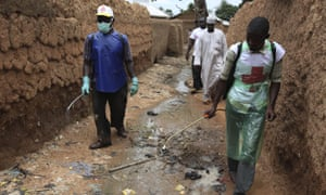 Healthcare workers spraying a chlorine solution to kill cholera bacteria in Ganjuwa in Bauchi state earlier this month.