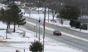 A car travels down a road in McKinney, Texas, U.S., on Tuesday, Feb. 16, 2021. Blackouts left almost 5 million customers without electricity, while refineries and oil wells were shut during unprecedented freezing weather.