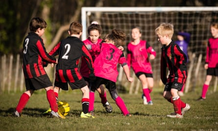 Schoolchildren playing football