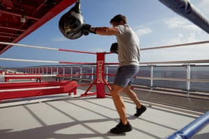 A man boxes on the Scarlet Lady