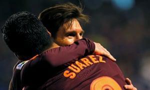 Lionel Messi and Luis Suárez celebrate winning the title.