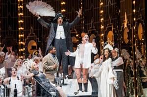 Lukhanyo Moyake as Alfredo, centre, and Claudia Boyle as Violetta, far right, in ENO's new La Traviata.