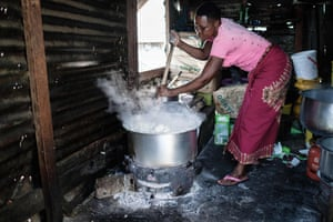 A woman prepares Ugali, a typical local food made of maize flour