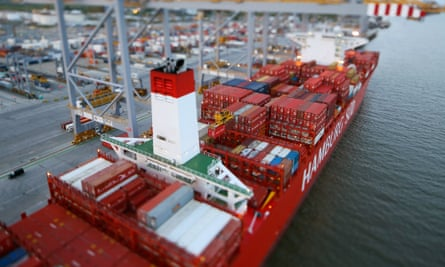 Freight containers sit on the deck of the Cap San Lorenzo container ship, operated by Hamburg Sud,at London Gateway deep-sea port, in Stanford-le-Hope