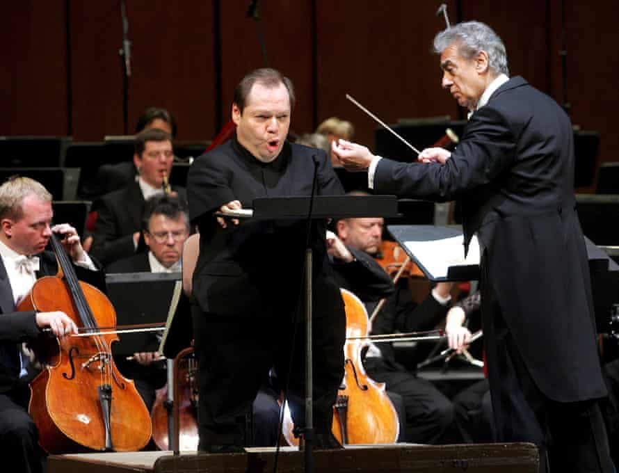 Placido Domingo conducts as Quasthoff sings during dress rehearsals for the inaugural concert to mark the opening of the Theater an der Wien in Vienna in 2005.