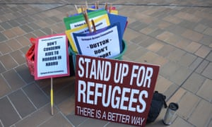 Asylum seeker advocate signs lie on the ground after the high court ruling