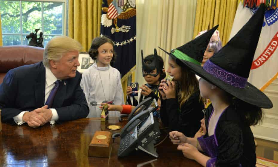 Donald Trump meets journalists' children in Halloween costumes.
