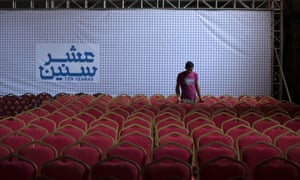 A man prepares a hall for a screening of 10 Years in Gaza; the city's first cinema screening in more than 30 years.