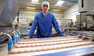Wilf Lewis by the halal food production line at his family's firm in Swansea, Wales.