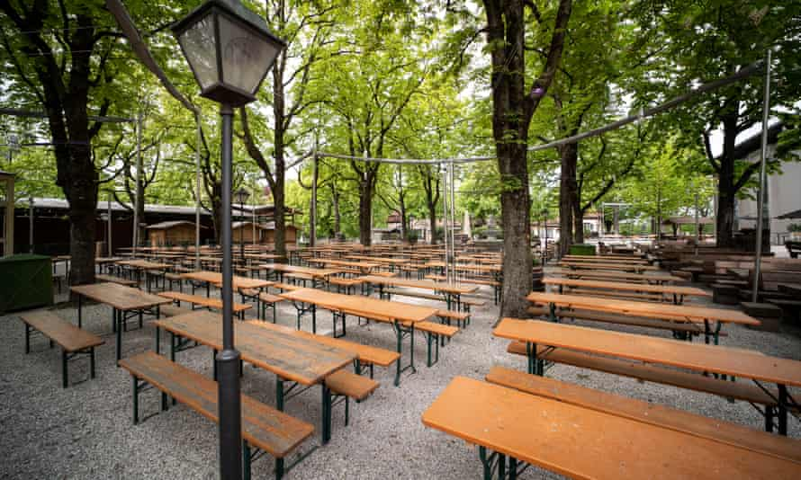 Empty tables at the Paulaner Nockherberg beer garden in Munich