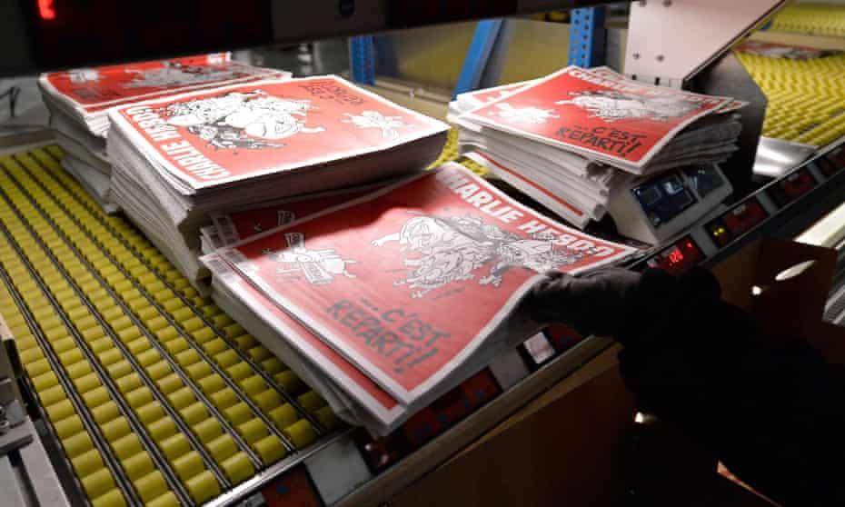 Charlie Hebdo's second edition since January's terrorist attack is prepared at a press distribution centre near Paris.