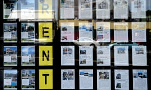 Houses for rent in a real estate agent's window