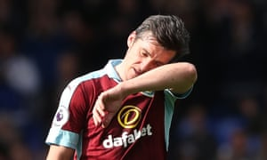 Burnley's Joey Barton has been banned from football for 18 months.