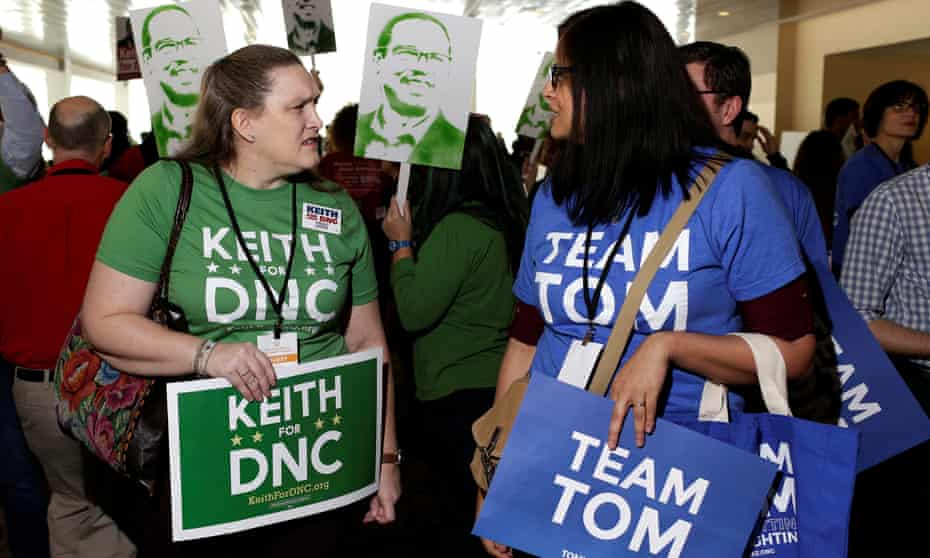 Supporters of Keith Ellison and Tom Perez, candidates for Democratic National Committee chairman, speak to each other during a DNC forum in Baltimore.