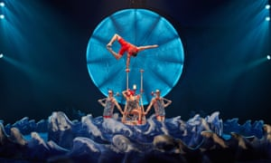 Movie glamour … handstander Ugo Laffolay as a lifeguard in Cirque du Solei's Luzia.