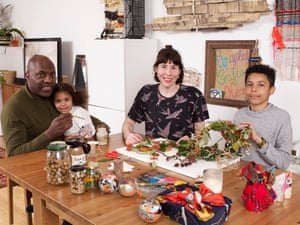 Maud Barrett, husband Rodney, daughter Lela and son Zak making Christmas decorations at home in London