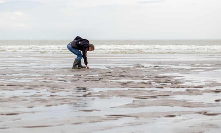 An amateur archaeologist on beach