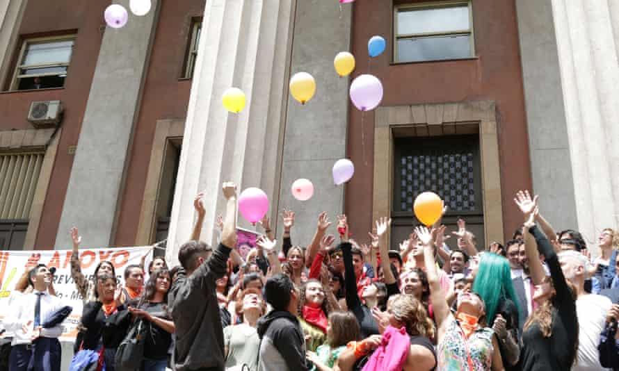 Activists celebrate outside a courthouse in Mendoza, Argentina Monday.