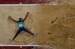 Luvo Manyonga celebrates his victory with a sand angel.