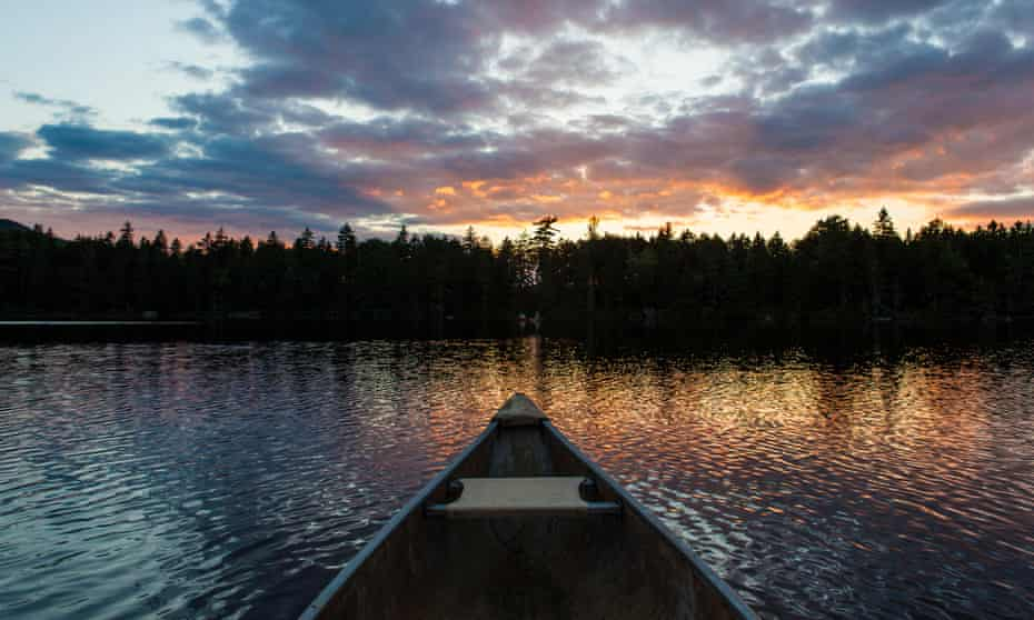 The bow of a canoe on Lang Pond in Maine's Northern Forest.