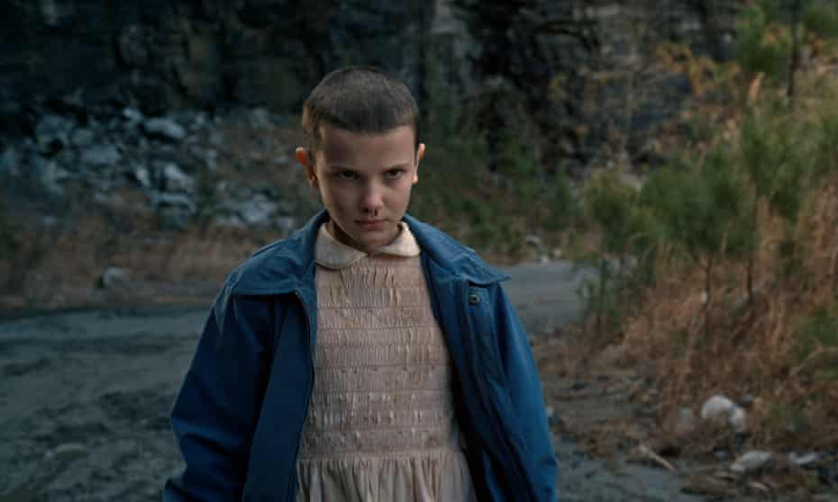 Our shaven-headed psychokinectically-powered heroine … Eleven (Millie Bobby Brown) in Stranger Things.