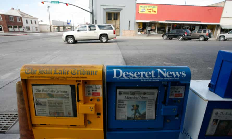 Local newspapers for sale in newspaper dispensers in the town of Salina, Utah.