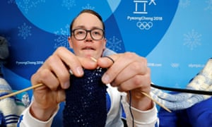 Antti Koskinen, snowboard head coach, shows off his knitting skills in Pyeongchang