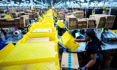 A woman works at a packing station at the 855,000-square-foot Amazon fulfillment center in Staten Island, New York.