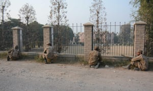 Pakistani soldiers stand guard near the site of the attack.