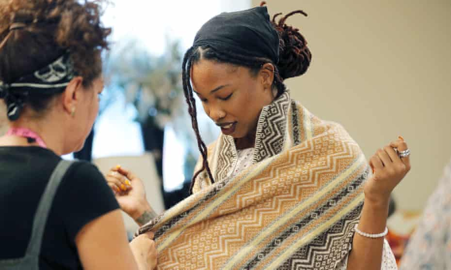 Courtney Brooks tries on her newly tailored costume. More than 200 years after the largest slave rebellion in US history, re-enactors will retrace their journey through south-eastern Louisiana.