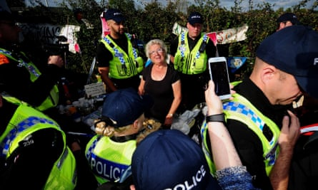 Police move tea lady Jackie Brookes from the Kirby Misperton fracking site.
