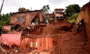 Damages after a landslide in Vila Bernadete, Belo Horizonte, Minas Gerais state, Brazil on Sunday.