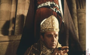 Richard Burton as Thomas Becket, Archbishop of Canterbury, about to be martyred at his cathedral, December 1170, in the 1964 film of the saint's life and his death by sword. A tunic widely held to be that of the saint, worn when he was assassinated, is set to return to Canterbury from Rome after more than five centuries.