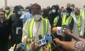 Nigeria's Minister of Information and Culture Lai Mohammed (C) gives statements to the media at the delivery ceremony of the first AronaZenec / Oxford coronavirus vaccine badge, provided by Covax.
