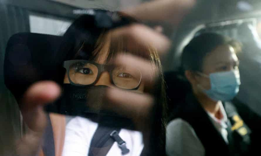 Chow Hang-tung is seen inside a vehicle after being detained in Hong Kong