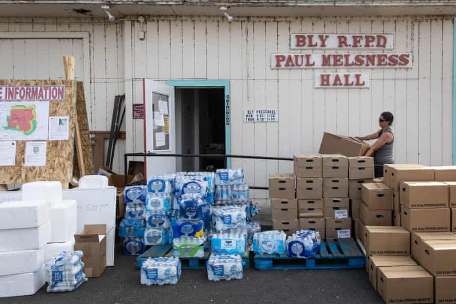 Valerie O'Dai brings boxes of donated items into the Bly Fire department.