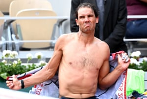 Rafael Nadal reacts during a break in play.