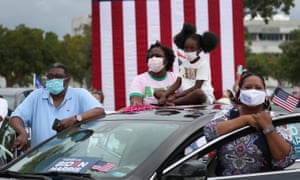 Voters listening to Obama at the drive-in rally in North Miami today.