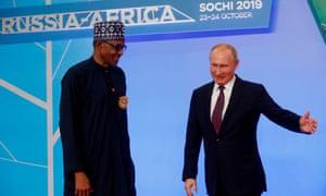 Russia's president, Vladimir Putin, greets Nigeria's president, Muhammadu Buhari, at the 2019 Russia-Africa summit in Sochi.