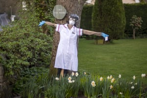 Manchester, England An NHS-themed scarecrow is displayed outside a house in Greenfield for the annual scarecrow parade