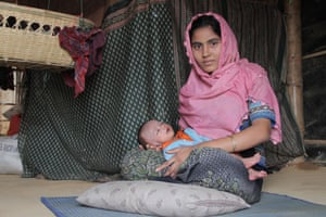 18-year-old Majuma Begum and her son Anwar Sadek in the Moinerghona refugee camp.