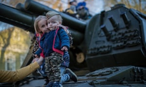 Children examine Russian military weapons on the streets of Samara three days prior to the Victory Day.