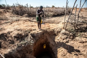 Alzira Simango, 31, collects water from a near-empty borehole in the district of Mabalane, southwest Malawi, where water has become harder and harder to find because of drought induced by El Niño weather patterns