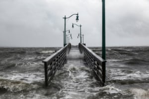 Strong gusts of wind and bands of heavy rain cover a walkway at the Jensen Beach causeway park.