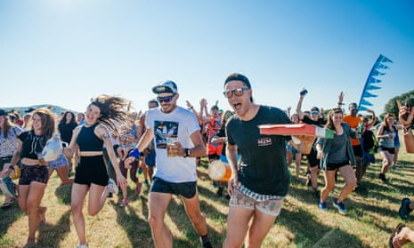 Revellers at 2019's Love Trails festival in Wales , which offers guided trail runs on the coast and in woodland, plus live music.