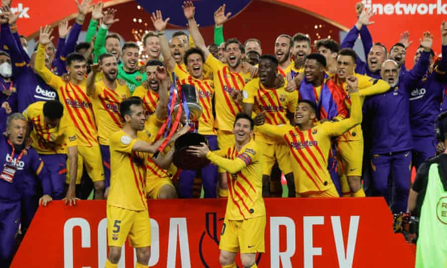 Barcelona celebrate with the Copa del Rey trophy after completely outplaying Athletic Bilbao.