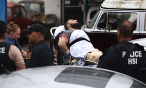 Ahmad Khan Rahami is taken into custody after a shootout with police Monday in Linden, New Jersey.